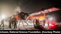 Rescue plane being serviced at South Pole station before taking off with sick workers.