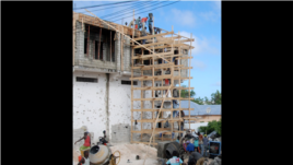 Construction workers restore a Bakara Market business destroyed in the August, 2011 fighting. (Pete Heinlein, VOA)