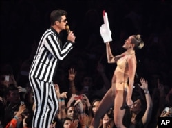 "From left, Robin Thicke and Miley Cyrus perform ""Blurred Lines"" at the MTV Video Music Awards on Aug. 25, 2013, at the Barclays Center in the Brooklyn borough of New York."