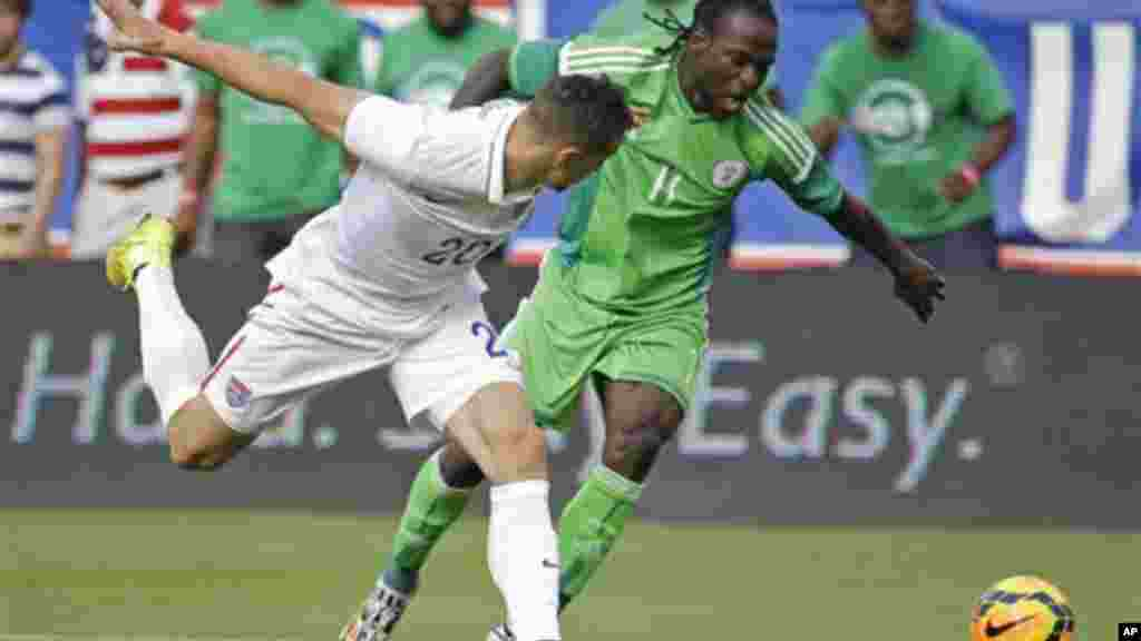 Nigeria's Victor Moses and United States's Geoff Cameron.