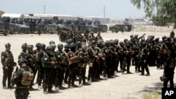 FILE - Iraq's elite counter-terrorism forces gather ahead of an operation to re-take the Islamic State-held City of Fallujah, outside Fallujah, Iraq, May 29, 2016.