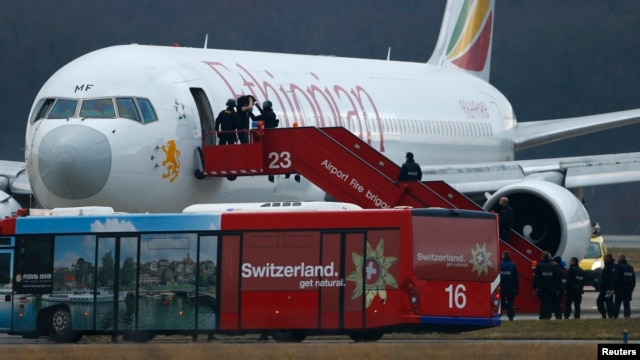 Swiss authorities detained the hijacker of an Ethiopian Airlines flight that was forced to land at Geneva's international airport, Feb. 17, 2014.