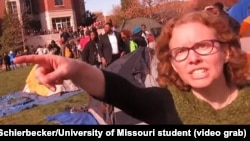 """FILE - University of Missouri communications professor Melissa Click is seen in a screenshot from a video shot by University of Missouri student photographer Mark Schierbecker, telling the photographer he """"needs to go"""" and can't videotape the student protesters,"""