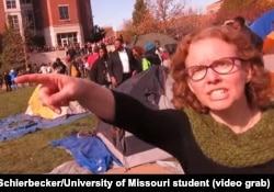 """University of Missouri communications professor Melissa Click is seen in a screenshot from a video shot by University of Missouri student photographer Mark Schierbecker, telling the photographer he """"needs to go"""" and can't videotape the student protesters."""