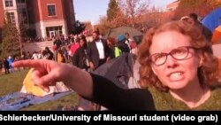"University of Missouri communications professor Melissa Click is seen in a screenshot from a video shot by University of Missouri student photographer Mark Schierbecker, telling the photographer he ""needs to go"" and can't videotape the student protesters,"