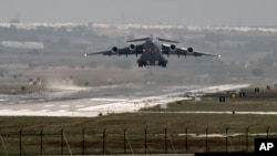 FILE - U.S. Air Force plane takes off from the Incirlik air base, in southern Turkey.