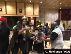 FILE: Ruling Zanu PF supporters celebrate in Harare, A ug. 3, 2018, after the Zimbabwe Electoral Commission declared their party the winner of Monday's polls in Zimbabwe.