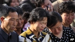 Families of victims of an accident at an apartment construction site in Pyongyang, North Korea, grieve during a gathering in the capital where senior officials apologized and took responsibility, May 17, 2014.