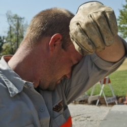 A worker making a road repair in Warr Acres, Oklahoma last week during a heat wave