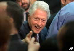 Former President Bill Clinton greets people in the audience after speaking in support of his wife, Democratic presidential candidate Hillary Clinton, at the Community College of Rhode Island in Warwick, R.I., April 14, 2016.
