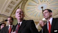 Senate Minority Leader Mitch McConnell of Ky., second from left, gestures during a news conference on Capitol Hill in Washington, Tuesday, Dec. 7, 2010. From left are, Sen. John Thune, R-S.D., McConnell, Sen. Lamar Alexander, R-Tenn., and Sen. John Barras
