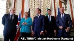 Francuski predsednik Emanuel Makron (u sredini) sa britanskim premijerom Borisom Džonsonom (krajnje levo), nemačkom kancelarkom Angelom Merkel (L), premijerom Italije u tehničkom mandatu Đuzepeom Konteom (D) i odlazećim predsednikom Evropskog saveta Donaldom Tuskom