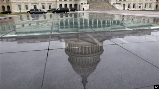 The dome of the Capitol is reflected in a skylight of the Capitol Visitor's Center in Washington, January 1, 2013.