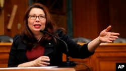 FILE - Sen. Tammy Duckworth, D-Ill., speaks on Capitol Hill, in Washington, Feb. 14, 2018.
