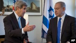 U.S. Secretary of State John Kerry, left, speaks with Israeli Prime Minister Benjamin Netanyahu during a meeting in Berlin, Germany, Oct. 22, 2015.