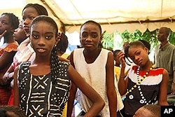Girls prepare to go on stage for their performance on the rights of the child