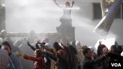 Water cannon are fired on female students during a protest at Al-Azhar University in Cairo, Dec. 11, 2013. (Hamada Elrasam for VOA)