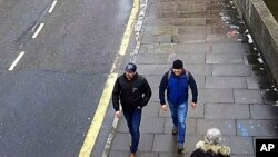 FILE - An image grab from CCTV, issued by the Metropolitan Police in London Sept. 5, 2018, shows men then identified as Ruslan Boshirov and Alexander Petrov walking on Fisherton Road, Salisbury, England, March 4, 2018. Boshirov has been unmasked as decora