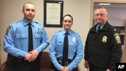 Officer Ashley Guindon, center, after she is sworn in as officer, Feb. 26, 2016. Guindon was shot and killed Saturday and two of her colleagues were wounded in a confrontation stemming from a call about an argument.