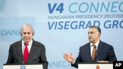 Israeli Prime Minister Benjamin Netanyahu, left, listens to Hungarian Prime Minister Viktor Orban during a press conference held after the talks of Netanyahu with heads of government of the Visegrad Group or V4 countries in the Pesti Vigado building in Bu