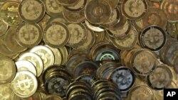 FILE - Bitcoins.