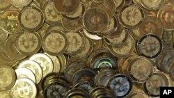 FILE - Bitcoin tokens at software engineer Mike Caldwell's shop in Sandy, Utah, April 3, 2013.