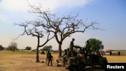 FILE - South Sudanese army soldiers are seen guarding Malakal town, 497km (308 miles) northeast of capital Juba, Dec. 30, 2013 after retaking the town from rebel fighters.