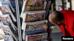 A man looks at newspapers at a kiosk in Diyarbakir, Turkey, Nov. 2, 2015.
