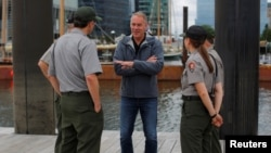 U.S. Interior Secretary Ryan Zinke, center, talks to National Park Service rangers while traveling for his National Monuments review process, in Boston, June 16, 2017.
