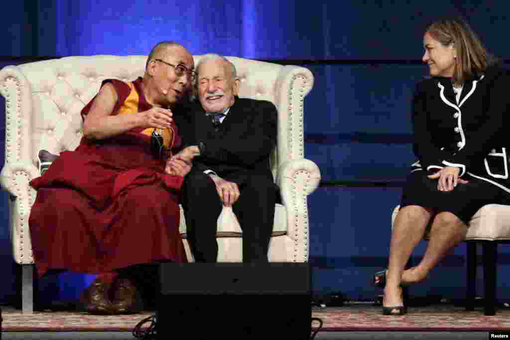 The Dalai Lama, seated with oceanographer Walter Munk (2nd L) and Congresswoman Loretta Sanchez (R), speaks at the University of California, Irvine. The Dalai Lama is celebrating his 80th birthday.