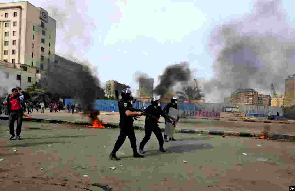 Egyptian riot police clash with protesters, not seen, near Tahrir Square, Cairo, Egypt, January 27, 2013.