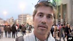 这张没有注明日期的照片显示的是美国记者詹姆斯•弗莱在利比亚班加西。