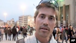 This undated file still image from video released April 7, 2011, by GlobalPost, shows James Foley of Rochester, N.H., a freelance contributor for GlobalPost, in Benghazi, Libya.
