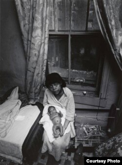 Bruce Davidson's photos of an impoverished neighborhood in New York included this gaunt-looking woman with a newborn on her lap.