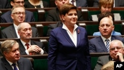 Beata Szydlo, candidate for prime minister from Law and Justice party, attends the inaugural session of the new parliament Nov. 12, 2015, in Warsaw, Poland.