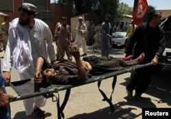 A man is carried to a hospital on a strecher after a car bomb attack in Lashkar Gah, Helmand province, Afghanistan, June 22, 2017.