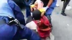 Police ebengani na makasi ba Congolais na basusu bazalaki na Sit-in na Cap (Afrika ya ngele)