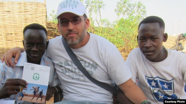 Gabriel Stauring, pictured here with two refugees, Rahma and Murtada, has been coordinating the Darfur United effort. (Photo courtesy i-Act charity)