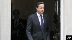 Britain's Prime Minister David Cameron leaves Downing Street in London, to attend Parliament, August 11, 2011