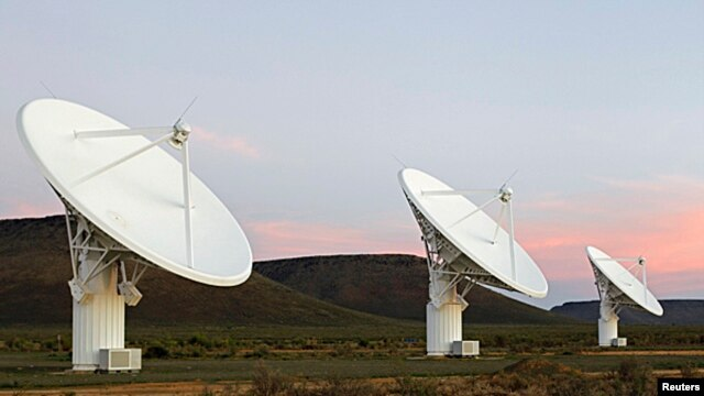 FILE - Radio telescope dishes of the KAT-7 Array at the proposed South African site for the Square Kilometre Array (SKA) telescope near Carnavon in the country's remote Northern Cape province,  May 17, 2012.