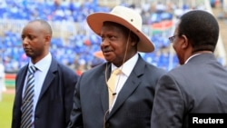 Uganda's President Yoweri Museveni (C) arrives at the national celebration to mark Kenya's Jamhuri Day (Independence Day) at the Nyayo Stadium in the capital Nairobi, Dec. 12, 2014.