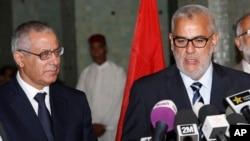 利比亚总理扎伊丹(左)。