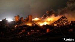 FILE - The remains of a fertilizer plant burn after an explosion at the plant in the town of West, near Waco, Texas, April 18, 2013.