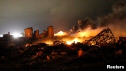 The remains of a fertilizer plant burn after an explosion at the plant in the town of West, near Waco, Texas, Apr. 18, 2013.