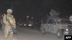Binh sĩ canh gác bên ngoài nhà tù ở phía Bắc thành phố Altamira, bang Tamaulipas, ngày 4/1/2012