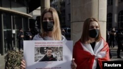 A woman displays a sign during a protest against the detention of Belarusian blogger, Roman Protasevich, who was detained as a Ryanair plane that he was on, en route from Athens to Vilnius, was forced to land in Minsk on Sunday, in Warsaw, Poland, May 24,
