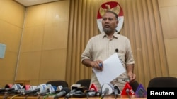 FILE - Bambang Widjojanto, former deputy chief of the Corruption Eradication Commission (KPK), is seen addressing the media in Jakarta.