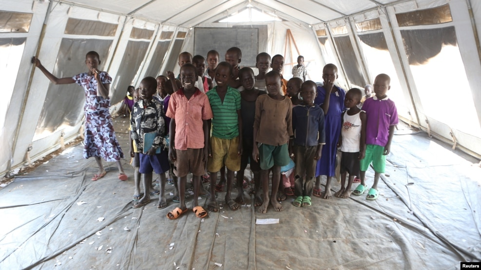 Children, who fled fighting in South Sudan, stand inside a tented classroom at the Bidi Bidi refugee resettlement camp near the border with South Sudan, in northern Uganda, Dec. 7, 2016.