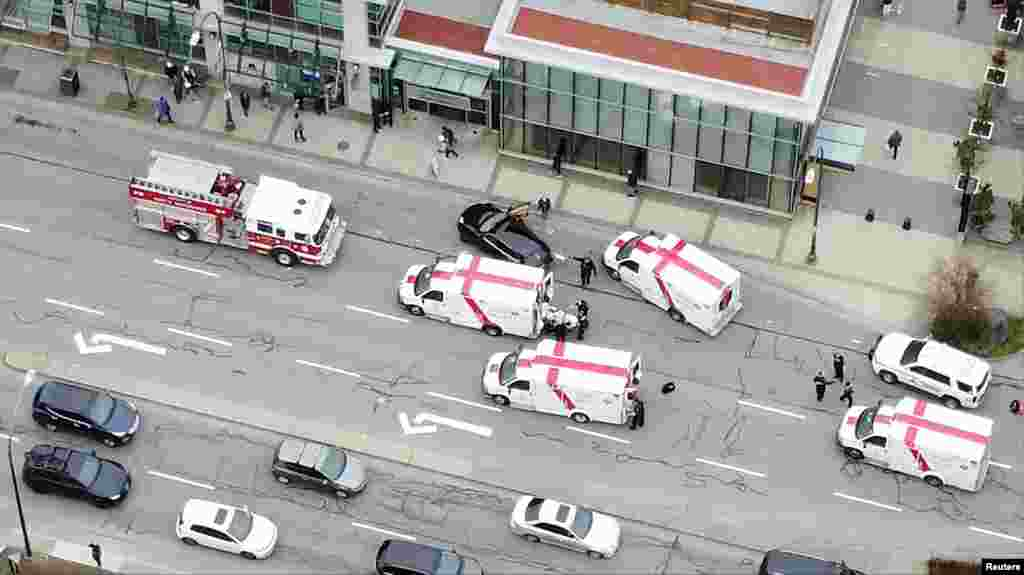 Ambulances and emergency personnel are seen on a road outside Lynn Valley Main Library, where police said multiple people were stabbed by a suspect who was later taken into custody, in North Vancouver, Canada, March 27, 2021, in this still image from video