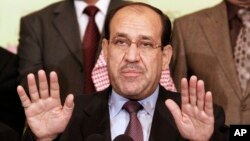 FILE - Iraqi Prime Minister Nouri al- Maliki speaks to the press in Baghdad, Iraq.